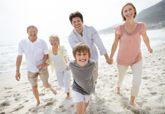 Happy family walking on the beach - Outdoor © Yuri Arcurs #7707022