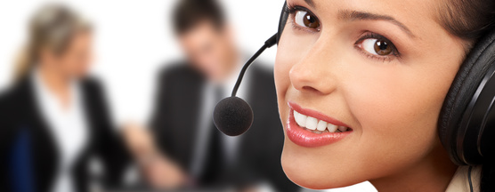Smiling  pretty business woman with headset. .